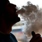 E-cigarettes are not considered as risky as regular cigarettes, but youth advocacy groups are worried about the dramatic rise in use among middle and high school students. (Associated Press/File)