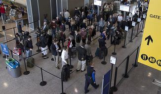 FILE - In this March 12, 2013, file photo, a line of travelers make their way around lines leading the TSA security checkpoint at Austin Bergstrom International Airport in Austin, Texas. Austin-Bergstrom International Airport officials are considering opening the airport's terminals to non-ticketed visitors who want to access the facility's food, beverage and retail offerings. (Rodolfo Gonzalez/Austin American-Statesman via AP, File)