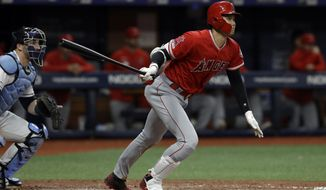 Los Angeles Angels' Shohei Ohtani, of Japan, watches his triple off Tampa Bay Rays' Ryan Yarbrough during the fifth inning of a baseball game Thursday, June 13, 2019, in St. Petersburg, Fla. Catching for the Rays is Mike Zunino. (AP Photo/Chris O'Meara)