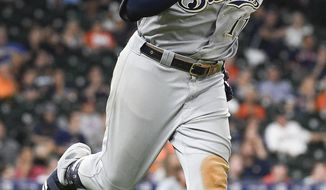Milwaukee Brewers' Mike Moustakas runs the bases after hitting a two-run home run off Houston Astros relief pitcher Cionel Perez during the 14th inning of a baseball game Wednesday, June 12, 2019, in Houston. (AP Photo/Eric Christian Smith)