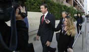 In this Dec. 3, 2018 file photo, Republican Rep. Duncan Hunter, center, leaves court in San Diego. The wife of U.S. Rep. Duncan Hunter pleaded guilty Thursday, June 13, 2019 to a single corruption count and agreed to testify against her husband at his trial on charges the couple spent more than $200,000 in campaign funds on trips, dinners, clothes and other personal expenses.  (AP Photo/Gregory Bull,File) **FILE**