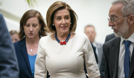 Speaker of the House Nancy Pelosi, D-Calif., leaves a caucus meeting on Capitol Hill in Washington, Wednesday, June 12, 2019. (AP Photo/J. Scott Applewhite)