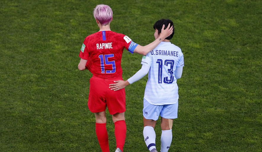 Thailand's Orathai Srimanee congratulates United States' Megan Rapinoe, left, after their Women's World Cup Group F soccer match between the United States and Thailand at the Stade Auguste-Delaune in Reims, France, Tuesday, June 11, 2019. The US defeated Thailand 13-0.(AP Photo/Francois Mori) **FILE**