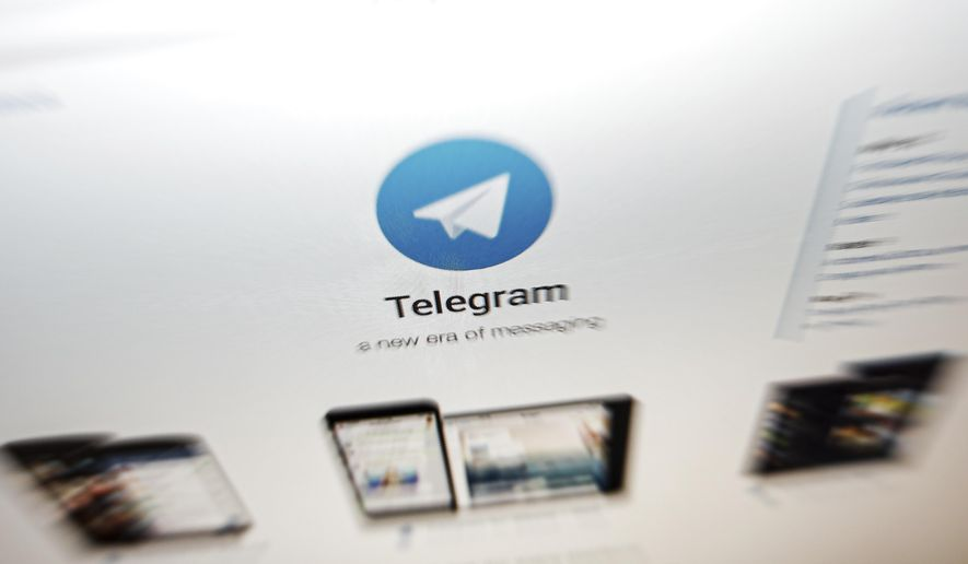 The website of the Telegram messaging app is seen on a computer's screen in Beijing, Thursday, June 13, 2019. Encrypted messaging app Telegram said Thursday that it was hit by a powerful cyberattack from China while massive protests were unfolding in Hong Kong. The attack, which slowed connectivity but did not compromise user data, came as hundreds of thousands took to the streets in Hong Kong to protest legislation that would allow people to be extradited to mainland China to stand trial. (AP Photo/Andy Wong)