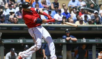 Minnesota Twins designated hitter Nelson Cruz hits a solo home run off a pitch by Seattle Mariners pitcher Yusei Kikuchi during the third inning of a baseball game, Thursday, June 13, 2019, in Minneapolis. (AP Photo/Craig Lassig)