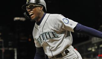 Seattle Mariners' Shed Long celebrates his three-run home run against the Minnesota Twins during the eighth inning of a baseball game Wednesday, June 12, 2019, in Minneapolis. (AP Photo/Bruce Kluckhohn)