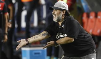 FILE - In this May 5, 2019 file photo, Dorados' head coach Diego Maradona shouts instructions to his players during extra time of a final leg match at a second division soccer league match against Atletico San Luis, in San Luis Potosi, Mexico. On the advice of his doctors, Maradona will not continue coaching the Dorados de Sinaloa, a second division Mexican team, according to the club and his representative on Thursday, June 13, 2019. (AP Photo/Eduardo Verdugo, File)