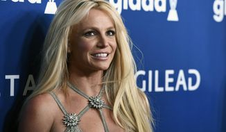 FILE - This April 12, 2018, file photo shows Britney Spears at the 29th annual GLAAD Media Awards in Beverly Hills, Calif. A Los Angeles judge is set to consider whether to extend a temporary restraining order taken out in the name of Spears against her former manager. The hearing Thursday, June 13, 2019, on the restraining order against Sam Lutfi is a resumption of one that began on May 28, with lawyers for Spears' intending to show that tweets and texts from Lutfi to Spears and her family are doing her emotional damage. (Photo by Chris Pizzello/Invision/AP, File)