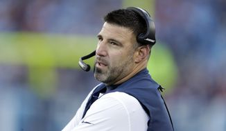 FILE - In this Dec. 22, 2018, file photo, Tennessee Titans head coach Mike Vrabel watches from the sideline during the first half of an NFL football game against the Washington Redskins in Nashville, Tenn. The Tennessee Titans wrapped up their three-day mandatory minicamp not on a football field but with a field trip to hit golf balls. Vrabel says the trip was the result of evaluating where the Titans are at the end of their offseason program and a last attempt to keep everyone healthy for training camp. (AP Photo/James Kenney, File)