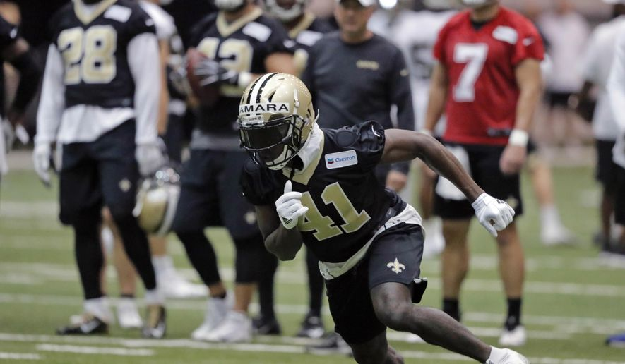 FILE - In this Tuesday, June 11, 2019, file photo, New Orleans Saints running back Alvin Kamara (41) runs a drill during NFL football practice in Metairie, La. Kamara says the offseason is a time for him to experiment with training methods and nutrition to improve as an athlete, and to continue studying pro football in hopes of adding new wrinkles to his already dynamic game. (AP Photo/Gerald Herbert, File)