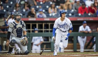 Kansas City Royals' Nicky Lopez watches his second-inning solo home run in front of Detroit Tigers catcher Grayson Greiner during a baseball game Thursday, June 13, 2019, in Omaha, Neb. (Chris Machian/Omaha World-Herald via AP)