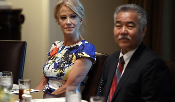 """White House counselor Kellyanne Conway, left, and Hawaii Gov. David Ige listen as President Donald Trump speaks during a meeting with governors on """"workforce freedom and mobility"""" in the Cabinet Room of the White House, Thursday, June 13, 2019, in Washington. (AP Photo/Evan Vucci)"""