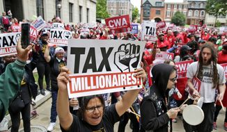 Protesters rally against benefit cuts in Trenton, N.J., Thursday, June 13, 2019. Spurred on by a tweet from U.S. Sen. Bernie Sanders, thousands of union members crowded around New Jersey's legislative annex Thursday, even spilling into the street, to protest state Senate President Steve Sweeney's calls to cut some worker benefits. (AP Photo/Seth Wenig)