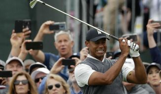 Tiger Woods reacts after his tee shot on the fifth hole during the first round of the U.S. Open Championship golf tournament Thursday, June 13, 2019, in Pebble Beach, Calif. (AP Photo/Matt York)