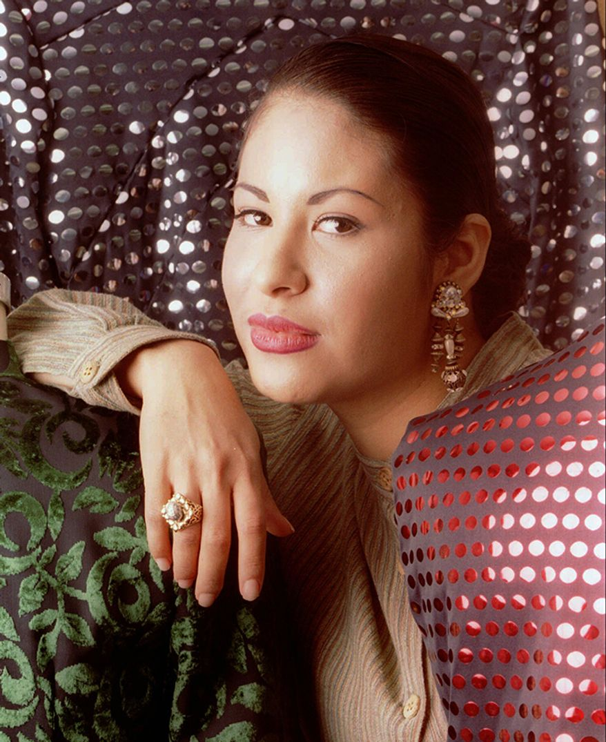 Selena (April 16, 1971  March 31, 1995) was an American singer, songwriter, actress, and fashion designer. Called theQueen of Tejano music, her contributions to music and fashion made her one of the most celebratedMexican-Americanentertainers of the late 20th century. She also ranksamong the most influential Latin artists of all timeand is credited for catapulting a music genre into themainstreammarket.                                                                                     In 1994, Selena and her family appointedYolanda Saldívaras manager of Selena's boutiques.In December 1994, the boutiques began to suffer after the number of staff for both stores had decreased.By January 1995, Selena's fashion designer Martin Gomez, her cousin Debra Ramirez, and clients expressed their concerns over Saldívar's behavior and management skills. It was later discovered that Saldívar had embezzled more than $30,000 via forged checks from both the fan club and the boutiques. In the days before Selena's death, Saldívar delayed handing over the bank statements and financial records by saying she had been physically and sexually assaulted in Mexico. Selena later met with Saldívar in her hotel room at theDays Innin Corpus Christi.At the hotel, Selena demanded the financial papers. At 11:48a.m., Saldívar got a gun from her purse and pointed it at Selena.As Selena attempted to flee, Saldívar shot her once on the right lower shoulder, severing an artery and causing a severe loss of blood. Critically wounded, Selena ran towards the lobby, leaving a long trail of blood.She collapsed on the floor as the clerk called the emergency services.Before collapsing, Selena named Saldívar as her assailant and gave the number of the room where she had been shot.Meanwhile, Saldívar attempted to leave in her pickup truck. She was, however, spotted by a responding police cruiser.[139]She surrendered after a nearly nine-and-a-half-hour standoff wi