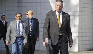 Alaska Gov. Mike Dunleavy walks to the podium at a news conference Friday, June 14, 2019, in Wasilla, Alaska. Dunleavy has called lawmakers into special session July 8  in Wasilla, and his administration gave a tour of the recommended site at Wasilla Middle School to reporters. (AP Photo/Mark Thiessen)