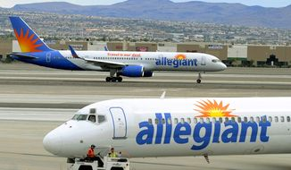 File - In this May 9, 2013, file photo, two Allegiant Air jets taxi at McCarran International Airport in Las Vegas. Federal safety regulators want to fine Allegiant Air more than $715,000, saying the discount airline failed to properly fix an engine that put out hotter-than-normal exhaust fumes. Allegiant says that it followed a procedure approved by the manufacturer and the government. (AP Photo/David Becker, File)