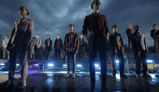 Models wear creations as part of the Ermenegildo Zegna men's Spring-Summer 2020 collection, unveiled during the fashion week, in Milan, Italy, Friday, June 14, 2019. (AP Photo/Luca Bruno)