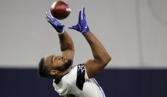 Dallas Cowboys tight end Rico Gathers (80) reaches up to secure a pass as he participates in drills at the team's NFL football training facility in Frisco, Texas, Wednesday, June 12, 2019. (AP Photo/Tony Gutierrez