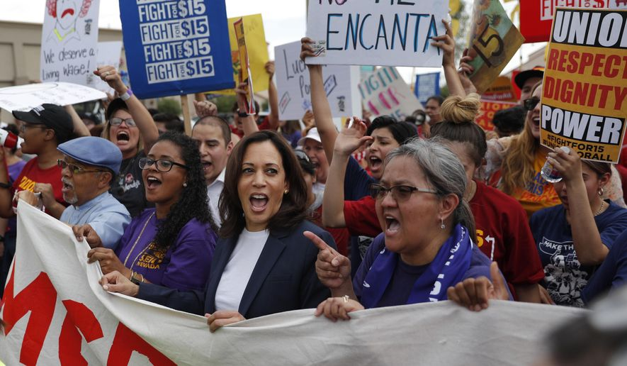 Democratic presidential candidate Sen. Kamala Harris, center left, D-Calif., marches with people protesting for higher minimum wage outside of McDonald's, Friday, June 14, 2019, in Las Vegas. (AP Photo/John Locher)