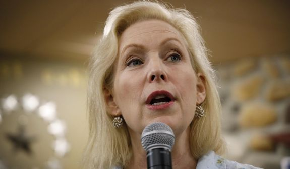 In this May 25, 2019, file photo, Democratic presidential candidate Sen. Kirsten Gillibrand speaks to local residents at a coffee shop in Mason City, Iowa. (AP Photo/Charlie Neibergall) ** FILE **