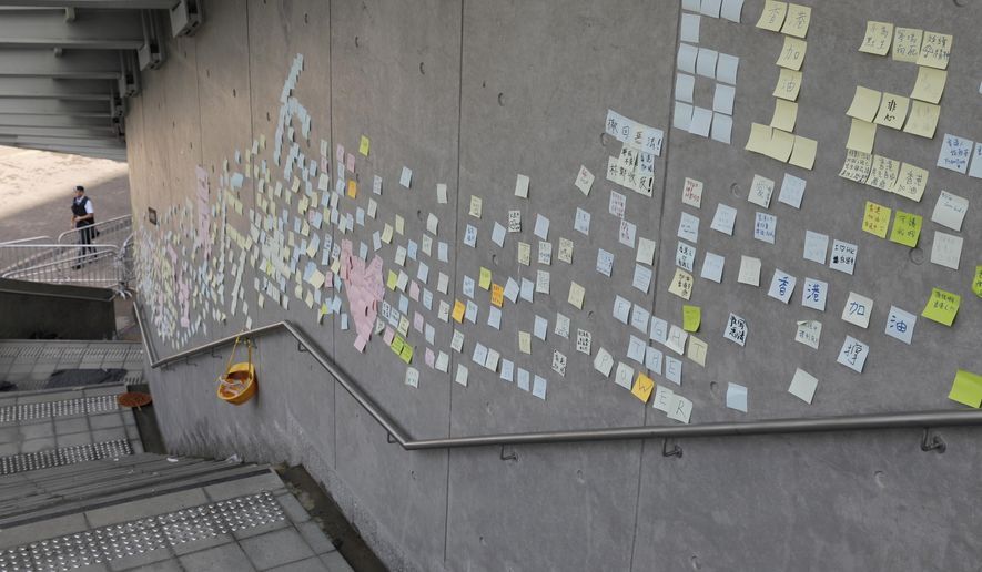 Stickers with messages supporting protesters are left on a wall near the Legislative Council in Hong Kong on Friday, June 14, 2019. Calm appeared to have returned to Hong Kong after days of protests by students and human rights activists opposed to a bill that would allow suspects to be tried in mainland Chinese courts. (AP Photo/Vincent Yu)
