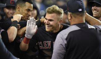 Cleveland Indians' Jake Bauers, center, is congratulated by teammates after hitting a two-run home run against the Detroit Tigers in the top of the eighth inning of a baseball game, Friday, June 14, 2019, in Detroit. (AP Photo/Jose Juarez)