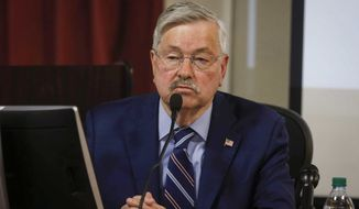 Former Iowa Gov. and current U.S. ambassador to China Terry Branstad testifies in the trial of a former state official who argues his pay was cut as part of an effort to force him out because he is gay, Friday, June 14, 2019, at the Polk County Courthouse in Des Moines, Iowa. (Bryon Houlgrave/The Des Moines Register via AP)