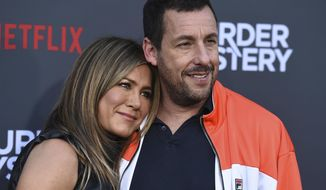 "Cast members Jennifer Aniston and Adam Sandler arrive at the Los Angeles premiere of ""Murder Mystery"" at the Regency Village Theatre on Monday, June 10, 2019 in Westwood, Calif. (Photo by Jordan Strauss/Invision/AP)"