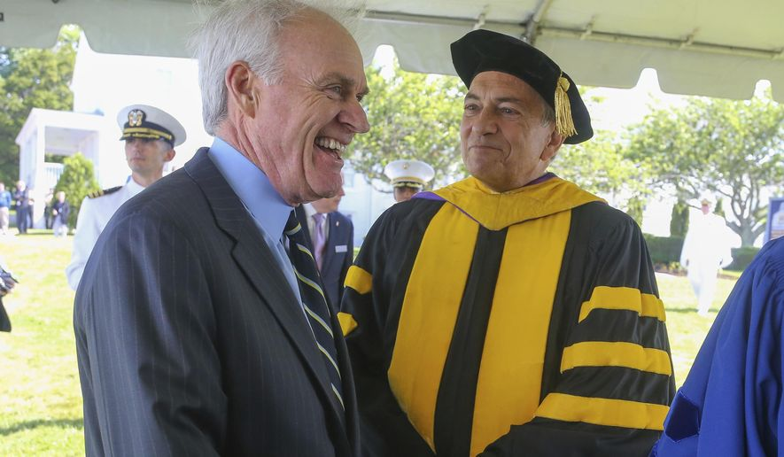Secretary of the Navy Richard Spencer, left, laughs while waiting with Acting President of the U.S. Naval War College Dr. Lewis Duncan, right, prior to the U.S. Naval War College's commencement ceremony, Friday, June 14, 2019, in Newport, R.I. (AP Photo/Stew Milne) ** FILE **