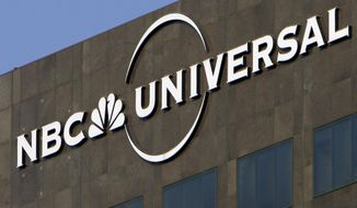 FILE - This Dec. 3, 2009, file photo, the NBC Universal logo hangs on a building in Los Angeles. NBCUniversal announced plans Friday, June 14, 2019, for a state-of-the-art television and film studio in a warehouse district just north of downtown Albuquerque. (AP Photo/Jae C. Hong, File)