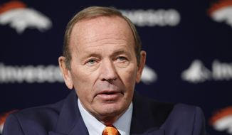 In this Jan. 5, 2011, photo, Broncos owner Pat Bowlen talks about Hall of Fame quarterback John Elway who he named Executive V.P. of football operations during a news conference at the team's headquarters in Englewood, Colo.  Bowlen, the Denver Broncos owner who transformed the team from also-rans into NFL champions and helped the league usher in billion-dollar TV deals, has died. He was 75. (AP Photo/ Ed Andrieski)