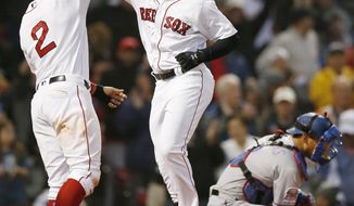 Boston Red Sox's Jackie Bradley Jr., center, celebrates his three-run home run with Xander Bogaerts (2), who scored, as Texas Rangers' Jeff Mathis kneels at home plate during the second inning of a baseball game in Boston, Thursday, June 13, 2019. (AP Photo/Michael Dwyer)