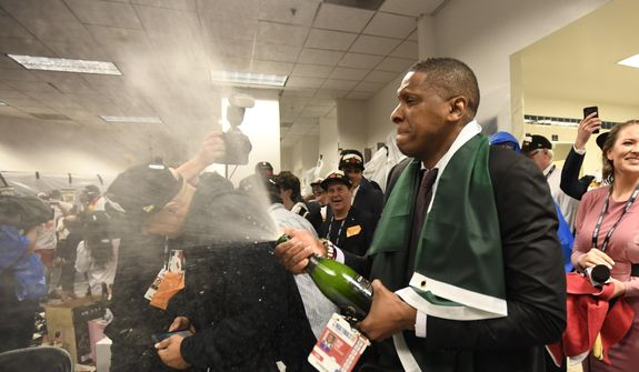 In this June 13, 2019, file photo, Toronto Raptors President Masai Ujiri celebrates after the team's 114-110 win over the Golden State Warriors in Game 6 of basketball's NBA Finals in Oakland, Calif. Authorities say they are investigating whether Toronto Raptors president Masai Ujiri pushed and hit a sheriff's deputy in the face as he tried to get on the court after his team won the NBA title in Oakland. (Frank Gunn/The Canadian Press via AP, File) **FILE**