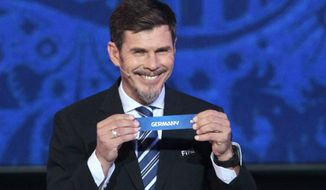FILE - In this Saturday, Nov. 26, 2016 file photo, Zvonimir Boban, FIFA's Deputy Secretary General for Football, holds the lot of Germany during the draw for the soccer Confederations Cup 2017, in Kazan, Russia. FIFA presidential adviser Zvonimir Boban is returning to AC Milan as its chief football officer, it was announced Friday, June 14, 2019. Boban has been the deputy secretary general with responsibility for soccer issues. FIFA says he is leaving within days. (AP Photo/Ivan Sekretarev, file)
