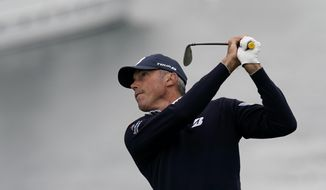 Matt Kuchar watches his tee shot on the seventh hole during the second round of the U.S. Open Championship golf tournament Friday, June 14, 2019, in Pebble Beach, Calif. (AP Photo/David J. Phillip)