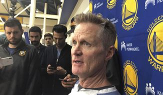 Golden State Warriors coach Steve Kerr talks with reporters at the NBA basketball team's practice facility Friday, June 14, 2019, in Oakland, Calif. Their three-peat quest denied by the champion Raptors, the Warriors now brace for major uncertainty ahead as Kevin Durant begins a long rehab from right Achilles tendon surgery and must decide where to sign and Klay Thompson has a torn left ACL that will be another lengthy recovery. (AP Photo/Janie McCauley)