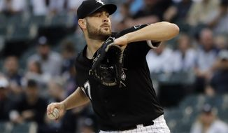 Chicago White Sox starting pitcher Lucas Giolito throws against the New York Yankees during the first inning of a baseball game in Chicago, Friday, June 14, 2019. (AP Photo/Nam Y. Huh)