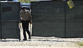 A security guard closes a gate at the construction site of a new clinic that is being built by Planned Parenthood in Birmingham, Ala., on Thursday, June 13, 2019. The organization is working on the project despite a new state law that virtually bans abortion in Alabama. (AP Photo/Jay Reeves)