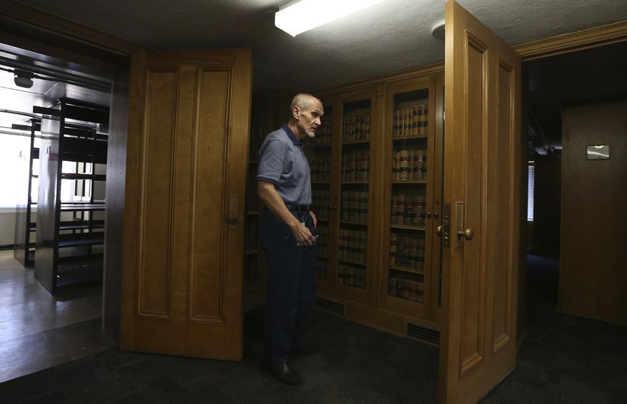 Mike Braun, executive director of the Arizona Legislative Council, pauses as he walks through the state's former library in the 1938 Arizona Capitol addition, Friday, June 14, 2019, in Phoenix. State officials and architects are pondering the future of newly vacated space in the Arizona Capitol complex, on the third floor of an annex sitting between the 118-year-old copper-domed Capitol and the nine-story Executive Tower. (AP Photo/Ross D. Franklin)