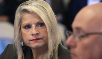 In this Wednesday, Jan. 28, 2015, file photo, Sen. Linda Collins-Smith, R-Pocahontas, listens to testimony at a meeting of the Senate Committee on Public Health, Welfare and Labor at the Arkansas state Capitol in Little Rock, Ark. Authorities on Friday, June 14, 2019, said they've arrested an Arkansas woman in connection with the killing of former state Sen. Linda Collins-Smith, who was found dead outside her own home, on June 4. (AP Photo/Danny Johnston, File)