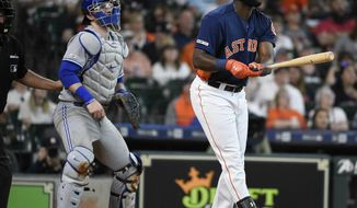 Houston Astros' Yordan Alvarez, right, watches his solo home run off Toronto Blue Jays starting pitcher Clayton Richard during the third inning of a baseball game, Saturday, June 15, 2019, in Houston. (AP Photo/Eric Christian Smith)