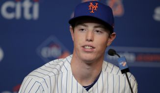New York Mets 2019 first round pick Brett Baty, a third baseman from Lake Travis High School in Austin, Texas, who was drafted 12th overall, speaks during a news conference after signing with the team prior to a baseball game against the St. Louis Cardinals, Saturday, June 15, 2019, in New York. (AP Photo/Julio Cortez)