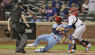 St. Louis Cardinals' Jack Flaherty, center, is tagged out by New York Mets catcher Wilson Ramos for the final out of a baseball game Saturday, June 15, 2019, in New York. The Mets won 8-7. (AP Photo/Julio Cortez)