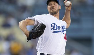 Los Angeles Dodgers starting pitcher Rich Hill throws during the first inning of the team's baseball game against the Chicago Cubs in Los Angeles, Friday, June 14, 2019. (AP Photo/Kyusung Gong)