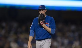 Chicago Cubs starting pitcher Kyle Hendricks walks off the field after being removed from the baseball game against the Los Angeles Dodgers during the fifth inning in Los Angeles, Friday, June 14, 2019. (AP Photo/Kyusung Gong)