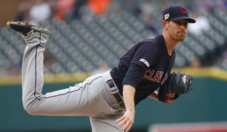 Cleveland Indians pitcher Shane Bieber watches a throw to a Detroit Tigers batter during the first inning of a baseball game in Detroit, Saturday, June 15, 2019. (AP Photo/Paul Sancya)