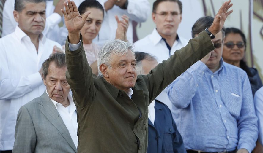 """Mexican President Andres Manuel Lopez Obrador receives the applause of the crowd during a rally in Tijuana, Mexico, Saturday, June 8, 2019. Mexican President Andres Lopez Obrador held the rally in Tijuana even as President Trump has put on hold his plan to begin imposing tariffs on Mexico on Monday, saying the U.S. ally will take """"strong measures"""" to reduce the flow of Central American migrants into the United States. (AP Photo/Eduardo Verdugo)"""
