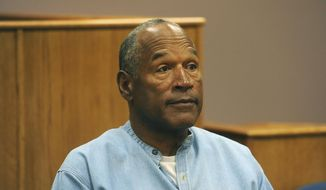 """In this July 20, 2017, file photo, former NFL football star O.J. Simpson appears via video for his parole hearing at the Lovelock Correctional Center in Lovelock, Nev.  Simpson has launched a Twitter account with a video post in which the former football star says he's got a """"little gettin' even to do."""" Simpson confirmed the new account to The Associated Press on Saturday, June 15, 2019. Simpson said in a phone interview it will be a lot of fun and that he had some things to straighten out. (Jason Bean/The Reno Gazette-Journal via AP, Pool, File) ** FILE **"""