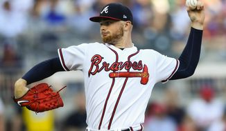 Atlanta Braves' pitcher Sean Newcomb pitches against the Philadelphia Phillies during the first inning of a baseball game Saturday, June 15, 2019, in Atlanta. (AP Photo/John Amis)
